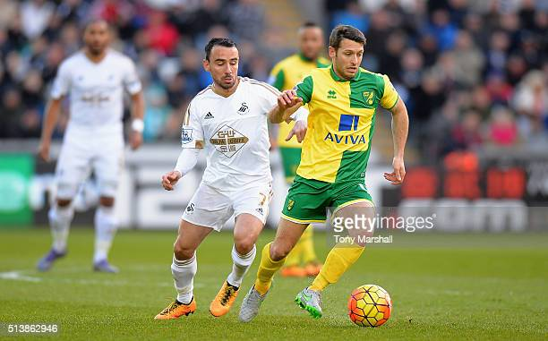 Wes Hoolahan of Norwich City controls the ball under pressure of Leon Britton of Swansea City during the Barclays Premier League match between...