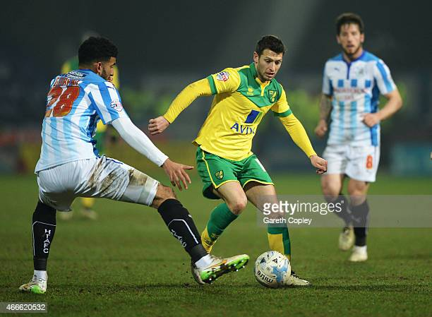 Wes Hoolahan of Norwich City is faced by Oscar Gobern of Huddersfield Town during the Sky Bet Championship match between Huddersfield Town and...