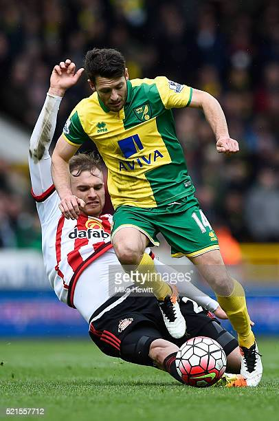 Wes Hoolahan of Norwich City is tackled by Jan Kirchhoff of Sunderland during the Barclays Premier League match between Norwich City and Sunderland...