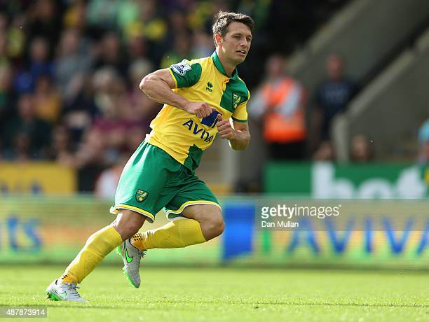 Wes Hoolahan of Norwich City looks on as he scores his team's second goal during the Barclays Premier League match between Norwich City and AFC...