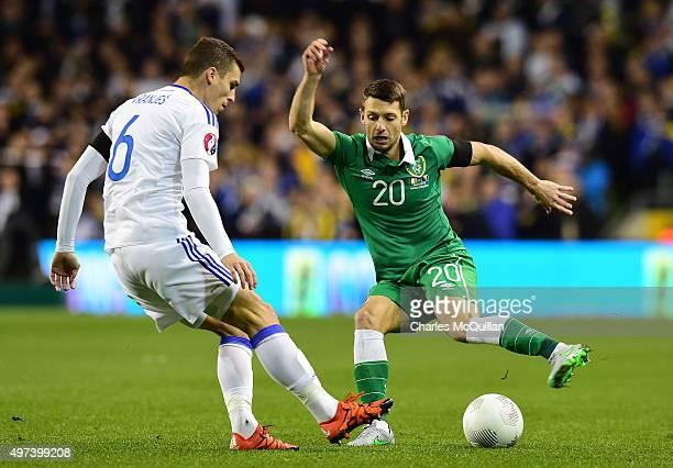 Wes Hoolahan of Republic of Ireland and Ognjen Vranjes BosniaHerzegovina during the Euro 2016 playoff second leg match at Aviva Stadium on November...
