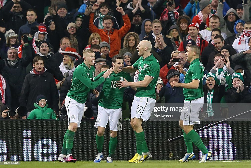 Wes Hoolahan of Republic of Ireland celebrates with team mates after scoring the second goal during the International Friendly match between Republic of Ireland and Poland at Aviva Stadium on February 6, 2013 in Dublin, Ireland.