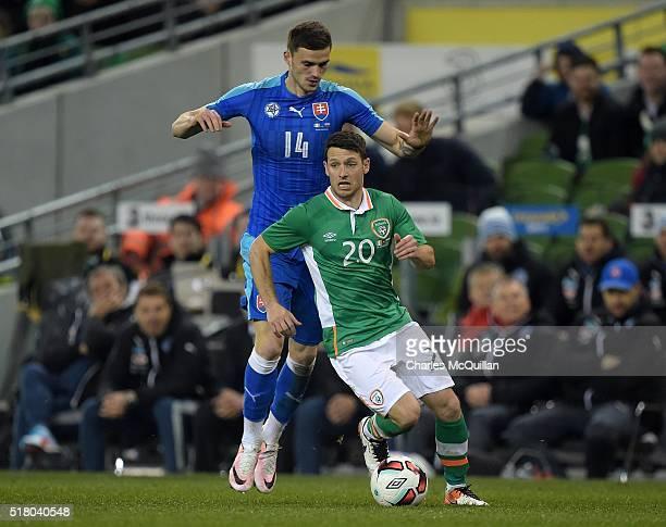 Wes Hoolahan of the Republic of Ireland and Erik Sabo of Slovakia during the international friendly match between the Republic of Ireland and...