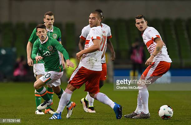 Wes Hoolahan of the Republic of Ireland and Pajtim Kasami of Switzerland during the international friendly match between the Republic of Ireland and...