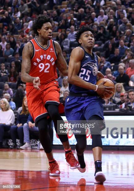 Wes Iwundu of the Orlando Magic shoots the ball as Lucas Nogueira of the Toronto Raptors defends during the first half of an NBA game at Air Canada...