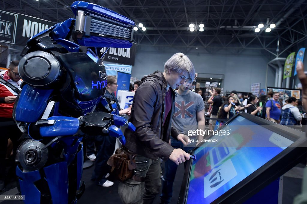 Wes Johnson and Damien Haas of the Smosh Games crew play the 'Schick Shave Off' video game with Schick Hydro At New York Comic-Con 2017 on October 6, 2017 in New York City.
