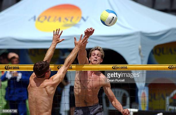 Wes Montgomery from Canada hits the ball past Al Hall during the More FM Beach Volleyball Open played at the ASB Tennis Centre Saturday Mark...