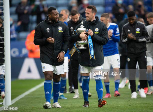 Wes Morgan and Christian Fuchs of Leicester City parade the FA Cup trophy after the Premier League match between Leicester City and Tottenham Hotspur...