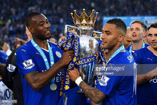 Wes Morgan and Danny Simpson of Leicester City pose for photographs with the Premier League Trophy as players and staffs celebrate the season...