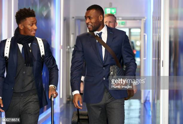 Wes Morgan and Demarai Gray ahead of the Premier League match between Leicester City and Huddersfield at King Power Stadium on January 01st 2018 in...