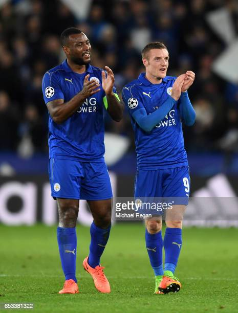 Wes Morgan and Jamie Vardy of Leicester City celebrate their team's 32 agg victory following the final whistle during the UEFA Champions League Round...
