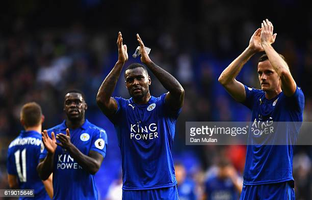 Wes Morgan and Leicester City players applauds away supporters after his team's 11 draw in the Premier League match between Tottenham Hotspur and...