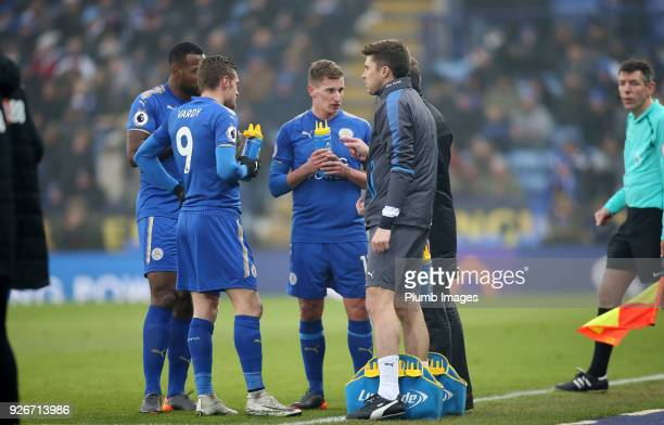 Wes Morgan Jamie Vardy and Marc Albrighton of Leicester City receive instructions from Manager Claude Puel of Leicester City during the Premier...