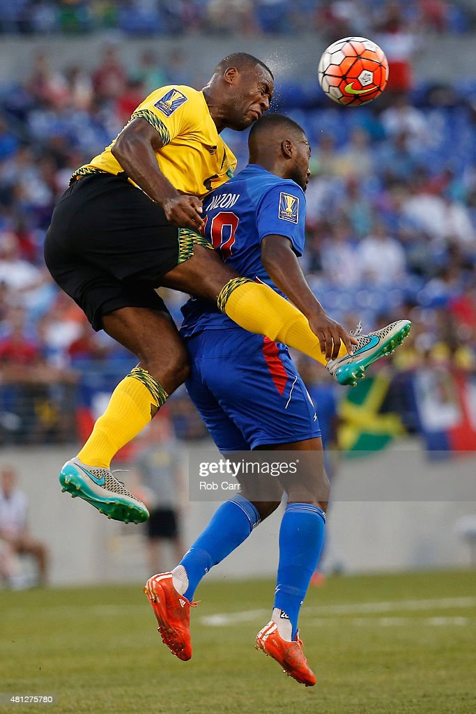 Wes Morgan #4 of Jamaica and Duckens Nazon #20 of Haiti go up for the ball in the first half during the 2015 CONCACAF Gold Cup quarterfinal match at M&T Bank Stadium on July 18, 2015 in Baltimore, Maryland.