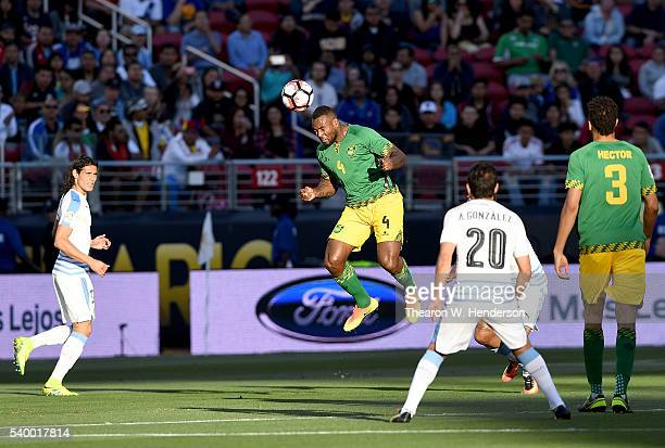 Wes Morgan of Jamaica hits a header against Uruguay during the 2016 Copa America Centenario Group match play between Uruguay and Jamaica at Levi's...