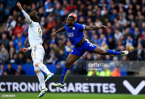 Wes Morgan of Leicester City and Alberto Paloschi of Swansea City jump for the ball during the Barclays Premier League match between Leicester City...