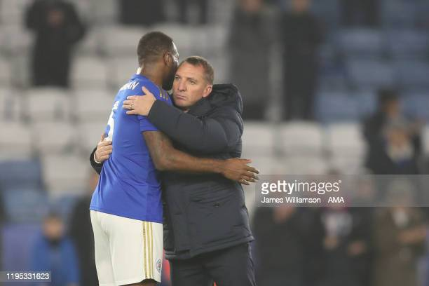 Wes Morgan of Leicester City and Brendan Rodgers at full time of the Premier League match between Leicester City and West Ham United at The King...