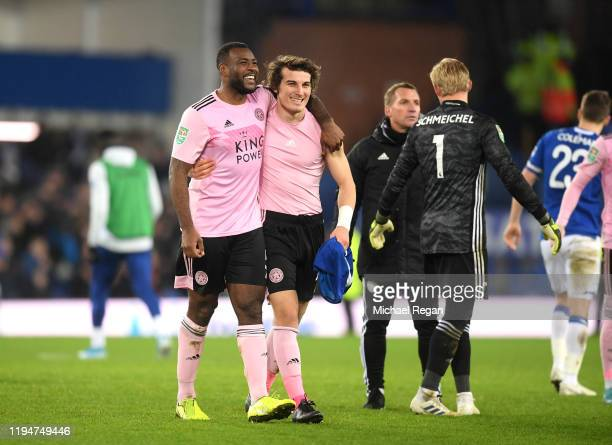 Wes Morgan of Leicester City and Caglar Soyuncu of Leicester City celebrate victory during the Carabao Cup Quarter Final match between Everton FC and...