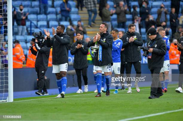 Wes Morgan of Leicester City and Christian Fuchs of Leicester City with the FA Cup at the end of the Premier League match between Leicester City and...
