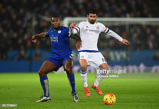 Wes Morgan of Leicester City and Diego Costa of Chelsea battlefor the ball during the Barclays Premier League match between Leicester City and...