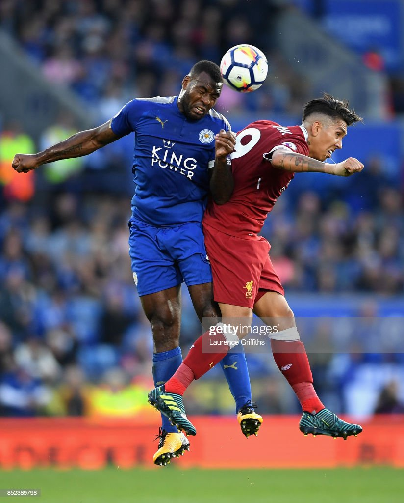 Wes Morgan of Leicester City and Roberto Firmino of Liverpool clash during the Premier League match between Leicester City and Liverpool at The King Power Stadium on September 23, 2017 in Leicester, England.