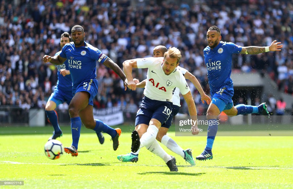 Wes Morgan of Leicester City battles for possession with Harry Kane of Tottenham Hotspur during the Premier League match between Tottenham Hotspur and Leicester City at Wembley Stadium on May 13, 2018 in London, England.