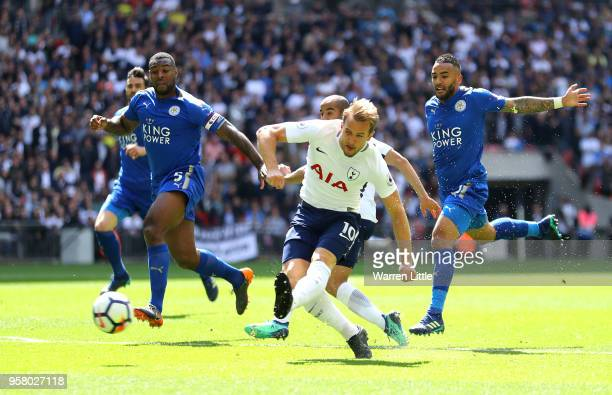 Wes Morgan of Leicester City battles for possession with Harry Kane of Tottenham Hotspur during the Premier League match between Tottenham Hotspur...