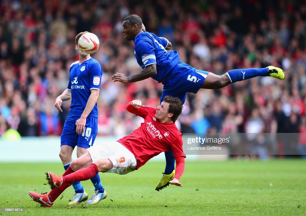 Wes Morgan of Leicester City battles with Darius Henderson of Nottingham Forest during the npower Championship match between Nottingham Forest and Leicester City at City Ground on May 4, 2013 in Nottingham, England.