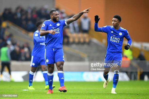 Wes Morgan of Leicester City celebrates after scoring his sides third goal with teammate Demarai Gray during the Premier League match between...