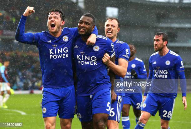 Wes Morgan of Leicester City celebrates after scoring his team's second goal with Ben Chilwell and Jonny Evans during the Premier League match...