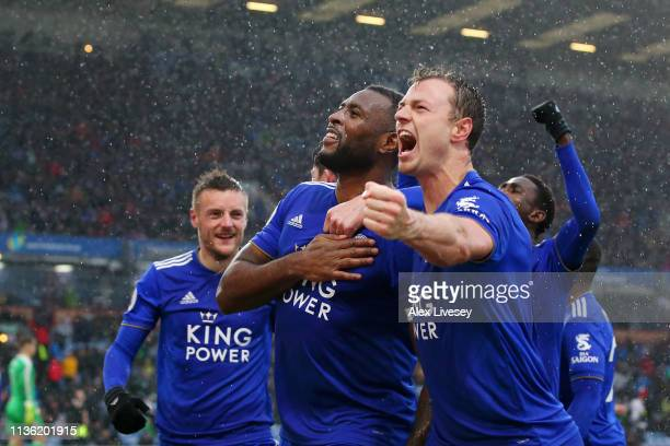 Wes Morgan of Leicester City celebrates after scoring his team's second goal with Jonny Evans during the Premier League match between Burnley FC and...