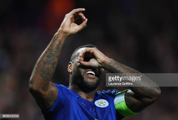 Wes Morgan of Leicester City celebrates after scoring the opening goal during the UEFA Champions League Round of 16 second leg match between...