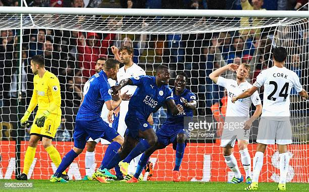 Wes Morgan of Leicester City celebrates scoring his sides second goal during the Premier League match between Leicester City and Swansea City at The...