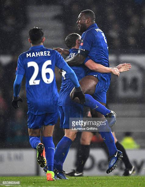 Wes Morgan of Leicester City celebrates scoring his sides second goal with team mates during The Emirates FA Cup Fourth Round match between Derby...