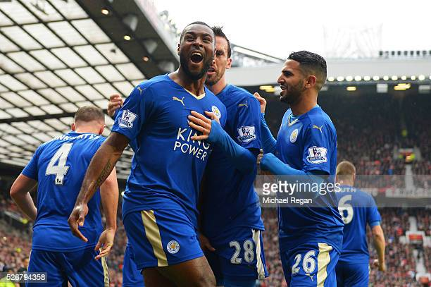 Wes Morgan of Leicester City celebrates scoring his team's opening goal with team mates during the Barclays Premier League match between Manchester...