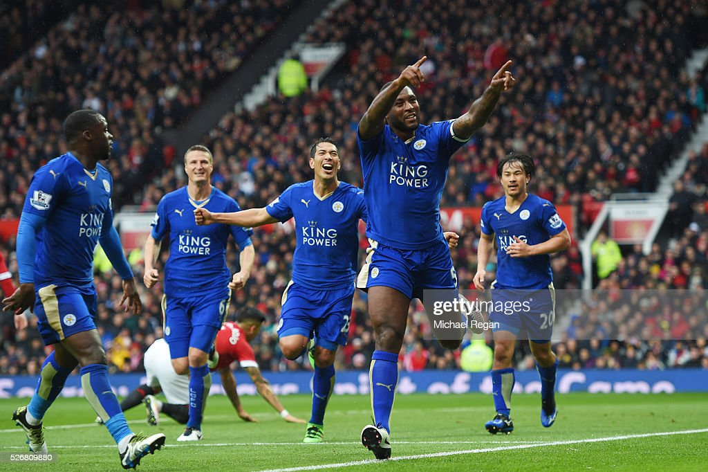 Wes Morgan of Leicester City celebrates scoring his team's opening goal with team mates during the Barclays Premier League match between Manchester United and Leicester City at Old Trafford on May 1, 2016 in Manchester, England.