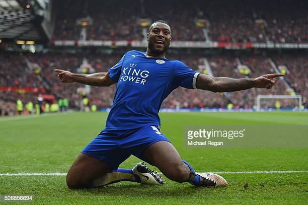 Wes Morgan of Leicester City celebrates scoring his team's opening goal during the Barclays Premier League match between Manchester United and...
