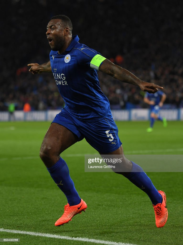 Wes Morgan of Leicester City celebrates scoring the opening goal during the UEFA Champions League Round of 16 second leg match between Leicester City and Sevilla FC at The King Power Stadium on March 14, 2017 in Leicester, United Kingdom.