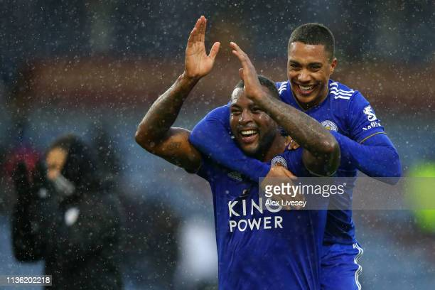 Wes Morgan of Leicester City celebrates victory with Youri Teilemans of Leicester City after the Premier League match between Burnley FC and...