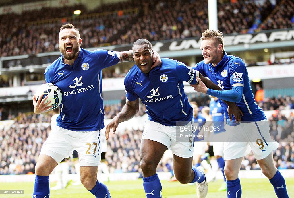 Wes Morgan of Leicester City celebrates with Jamie Vardy and Marcin Wasileski also of Leicester to make it 2-2 during the Premier League match between Tottenham Hotspur and Leicester City at White Hart Lane on March 21, 2015 in London, England.
