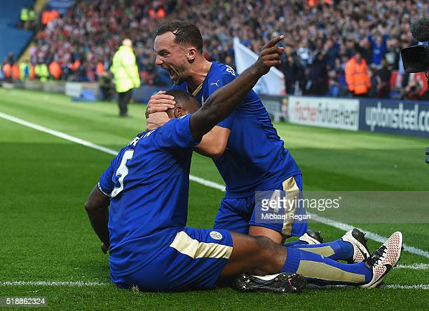 Wes Morgan of Leicester City celebrates with team mate Danny Drinkwater as he scores their first goal during the Barclays Premier League match...