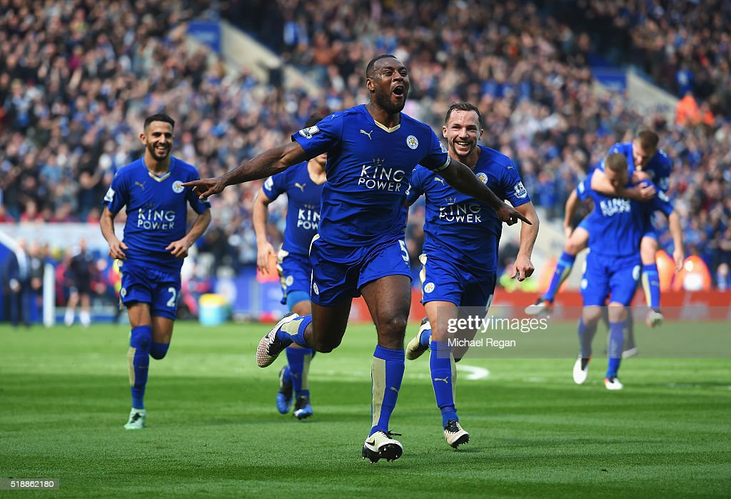 Wes Morgan of Leicester City celebrates with team mates as he scores their first goal during the Barclays Premier League match between Leicester City and Southampton at The King Power Stadium on April 3, 2016 in Leicester, England.