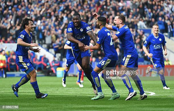 Wes Morgan of Leicester City celebrates with team mates as he scores their first goal during the Barclays Premier League match between Leicester City...