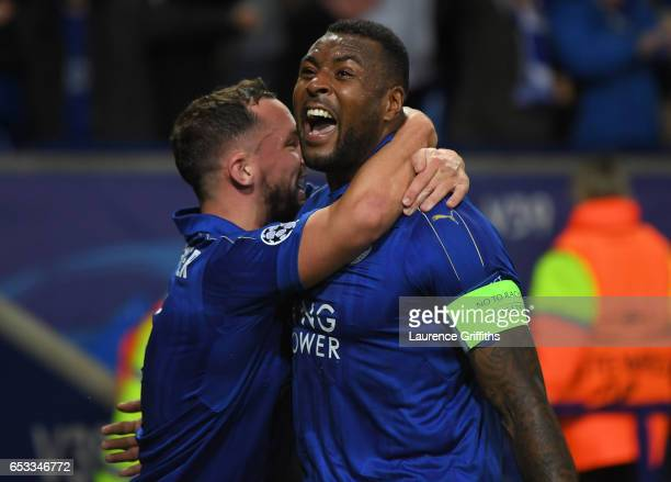 Wes Morgan of Leicester City celebrates with teammate Danny Drinkwater after scoring the opening goal during the UEFA Champions League Round of 16...