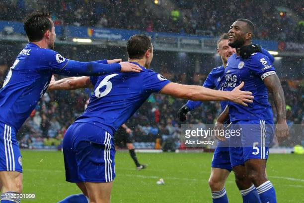 Wes Morgan of Leicester City celebrates with teammates after scoring his team's second goal during the Premier League match between Burnley FC and...