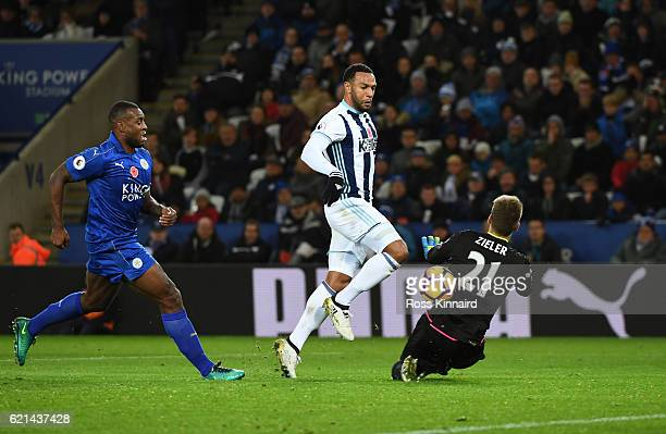 Wes Morgan of Leicester City closes down Matt Phillips of West Bromwich Albion as he chips RonRobert Zieler of Leicester City to score his sides...