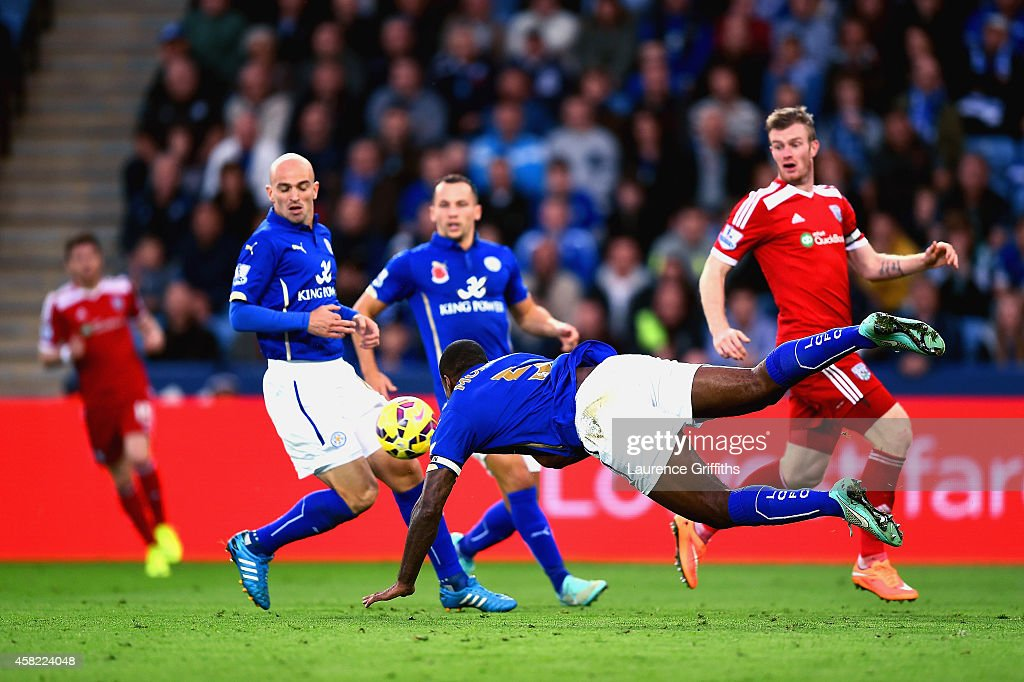Wes Morgan of Leicester City dives and heads the ball that rebounds of Esteban Cambiasso of Leicester City to score an own goal during the Barclays Premier League match between Leicester City and West Bromwich Albion at The King Power Stadium on November 1, 2014 in Leicester, England.