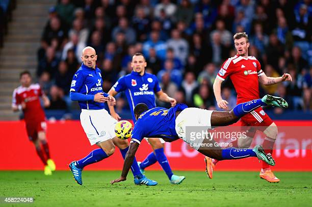 Wes Morgan of Leicester City dives and heads the ball that rebounds of Esteban Cambiasso of Leicester City to score an own goal during the Barclays...