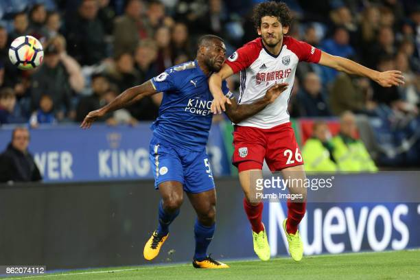 Wes Morgan of Leicester City in action with Ahmed Hegazi of West Bromwich Albion during the Premier League match between Leicester City and West...