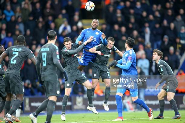 Wes Morgan of Leicester City in action with Ceasar Azpilicueta and Andreas Christensen of Chelsea during The Emirates FA Cup Quarter Final tie...